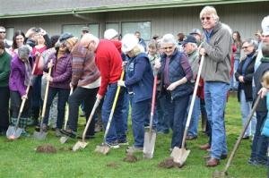 Members of the Pioneer community break ground for the new Middle School